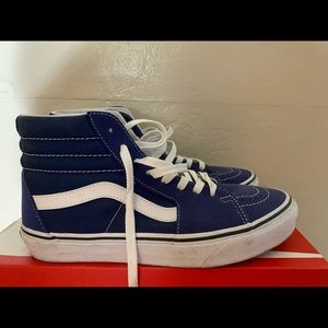 Navy blue and white high top vans